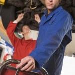 Two mechanics working under car — Stock Photo
