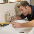 Plumber working on sink — Stock Photo