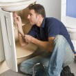 Plumber working on sink — Stock Photo #4770533