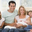 Family in living room with baby smiling — Stock Photo