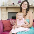 Mother in living room with baby smiling — Stock Photo #4770579