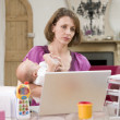Mother and baby in home office with laptop — Stock Photo