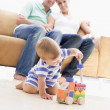 Couple in living room with baby smiling - ストック写真