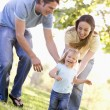 Stock Photo: Family running outdoors smiling