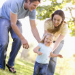 Family running outdoors smiling — Stock Photo #4770737