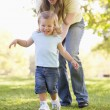 Mother and daughter playing outdoors smiling — Stock Photo #4770739