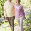 Couple walking outdoors smiling — Stock Photo