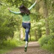 Stock Photo: Womjumping on path