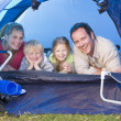 Family camping in tent smiling — Stock Photo #4771123