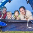 Stock Photo: Family camping in tent smiling