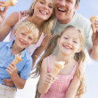 Family standing at beach with ice cream smiling — Stock Photo #4771130