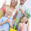 Family at beach with ice cream cones smiling — Stock Photo #4771169