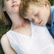Mother and son lying outdoors sleeping — Stock Photo