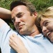 Couple lying outdoors smiling — Stock Photo #4771204