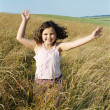 Young girl running outdoors smiling — Stock Photo