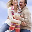 Couple standing outdoors smiling — Stock Photo #4771522