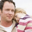 Father holding daughter at beach — Stock Photo