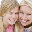 Mother and daughter at beach smiling — Stock Photo