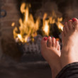 Feet warming at a fireplace — Stock Photo #4771633
