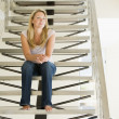 Woman sitting on stairs — Stock Photo