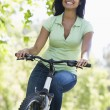 Woman on bicycle smiling — Stock Photo