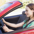Stock Photo: Woman in convertible car smiling