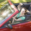 Woman in convertible car smiling — Stock Photo