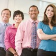 Business team standing indoors smiling — Stock Photo #4771890