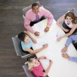 Five businesspeople at boardroom table — Stock Photo #4771893
