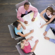 Five businesspeople at boardroom table — Stock Photo