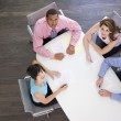 Four businesspeople at boardroom table — Stock Photo
