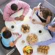 Four businesspeople at boardroom table with breakfast — Stock Photo #4771906