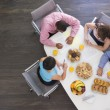 Four businesspeople at boardroom table with breakfast — Stock Photo