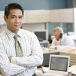 Stock Photo: Businessmstanding in cubicle
