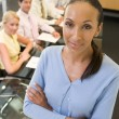 Businesswoman with four businesspeople at boardroom table in bac — Stock Photo #4772050