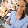 Businesswoman with four businesspeople at boardroom table in bac — Stock Photo #4772052
