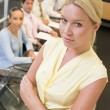 Businesswoman with four businesspeople at boardroom table in bac — Stock Photo