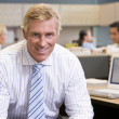 Stock Photo: Businessman in cubicle smiling