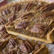 Pecan Pie With A Slice Being Cut - Stok fotoğraf