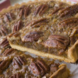 Pecan Pie With A Slice Being Cut - Stock Photo