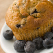 Blueberry Muffin On A Plate With Blueberries — Stock Photo