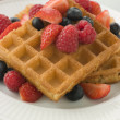 Plate Of Waffles With Berries And Maple Syrup - Stock Photo