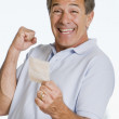 Man with winning lottery ticket excited and smiling — Stock Photo