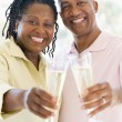 Couple toasting champagne and smiling — Stock Photo
