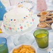 Birthday party table setting with food — Stock Photo