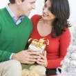 Husband Surprising Wife With Christmas Present — Stock Photo #4778289