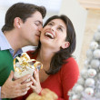 Husband Surprising Wife With Christmas Present — Stock Photo