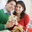 Husband Surprising Wife With Christmas Present — Stock Photo #4778297
