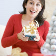 Woman Excited To Open Christmas Present — Zdjęcie stockowe #4778299