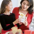 Girl Surprising Her Mother With Christmas Gift — Stockfoto